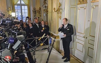 Permanent secretary of the Swedish Academy, Peter Englund, announces French writer Patrick Modiano as the winner of the 2014 Nobel Prize in Literature, Thursday Oct. 9, 2014, in Stockholm, Sweden. The prize was awarded 'for the art of memory with which he has evoked the most ungraspable human destinies and uncovered the life-world of the occupation,' the Swedish Academy said. (photo credit: AP Photo / Anders Wiklund)