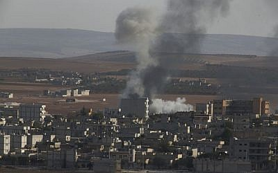 Smoke rises following an airstrike by US-led coalition aircraft in Kobani, Syria, during fighting between Syrian Kurds and the militants of Islamic State group, Thursday, Oct. 9, 2014 (photo credit: AP/Lefteris Pitarakis)