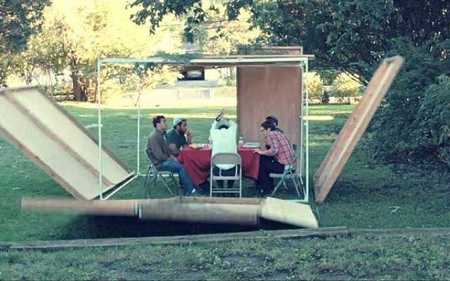 "Sukkahs keep falling in Rogers Park's ""Sukkah's Falling"" parody video. (YouTube screenshot)"