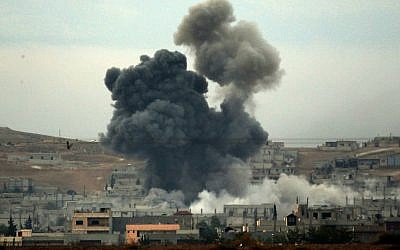 Thick smoke rises following an airstrike by the US-led coalition in Kobani, Syria while fighting continued between Syrian Kurds and the Islamic State group, as seen from Mursitpinar on the outskirts of Suruc, at the Turkey-Syria border, Oct. 14, 2014. (Photo credit: Lefteris Pitarakis/AP)