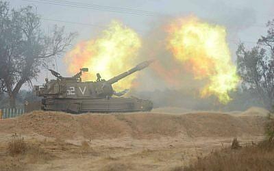 An IDF artillery piece firing toward Gaza during Operation Protective Edge (photo credit: IDF Spokesperson's Unit)