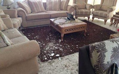 Ibrahim Barzak's living room after it was hit by an Israeli rocket. (photo credit: Ibrahim Barzak/JTA)