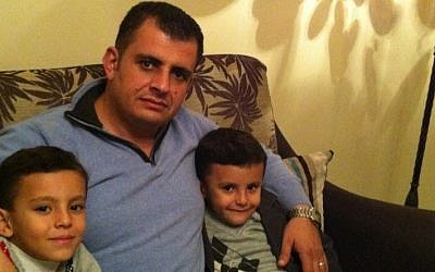 Ibrahim Barzak with his sons before leaving Gaza. (photo credit: Courtesy Ibrahim Barzak)