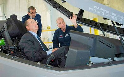 Lockheed Martin Aeronautics Company Chief Test Pilot Alan Norman briefs Israel's Minister of Defense Moshe Ya'alon in the cockpit of an F-35 while IAF Brig. Gen. Ya'akov Shaharabani, IAF Air Attache to the United States, observes. (Courtesy: Lockheed Martin/ Angel Delcueto)