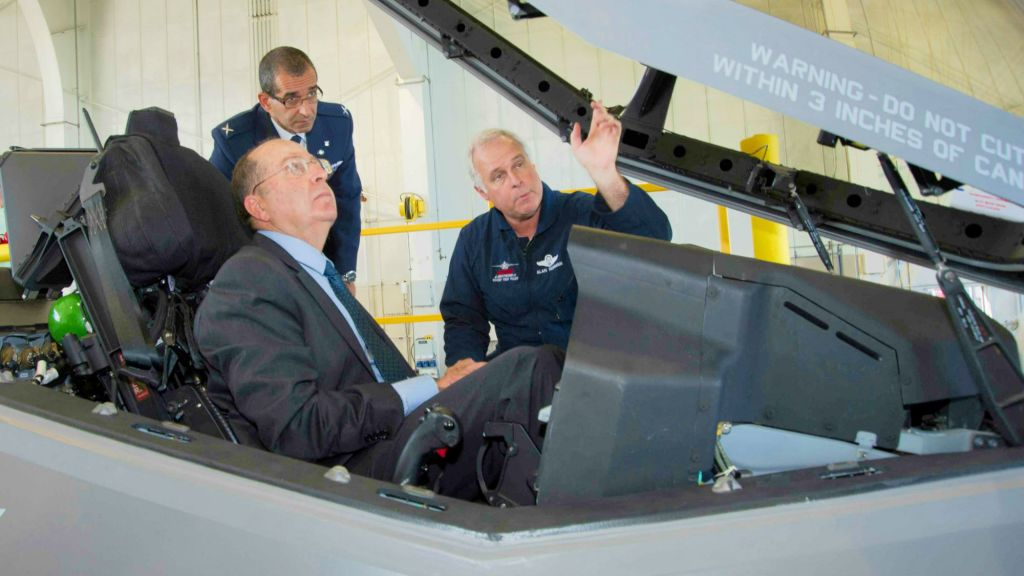 Lockheed Martin Aeronautics Company Chief Test Pilot Alan Norman briefs Israel's Minister of Defense Moshe Ya'alon in the cockpit of an F-35 while IAF Brig. Gen. Ya'akov Shaharabani, IAF Air Attache to the United States, observes. (Photo credit: courtesy: Lockheed Martin/ Angel Delcueto)