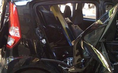 A car after a cigarette-lighter explosion destroyed the backseat, in Petah Tikva, on October 6, 2014. (photo credit: courtesy Magen David Adom)