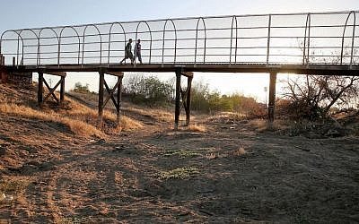 A footbridge spanning a dry riverbed in Porterville, California, on September 4, 2014. (Justin Sullivan/Getty Images/JTA)