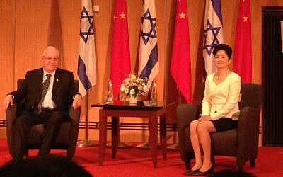 President Reuven Rivlin (R.) and China's  former Ambassador to Israel Gao Yanping at an event in Tel Aviv commemorating National Day, the 65th anniversary of the founding of modern China (Photo credit: Courtesy)