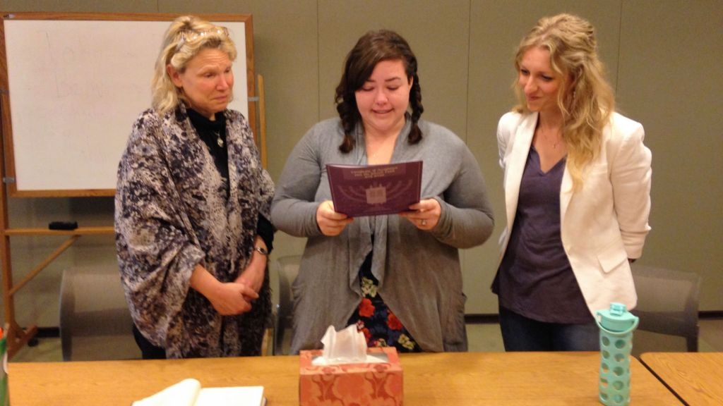 Missy Jane, center, reads her declaration of faith as she converts to Judaism during a ceremony at the Academy for Jewish Religion, May 9, 2014. (Adam Greenwald/JTA)