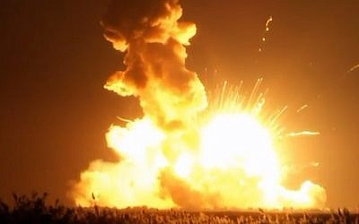 An unmanned rocket owned by Orbital Sciences Corporation explodes seconds after launch Tuesday night, October 28, 2014 (Photo credit: Youtube screen capture)