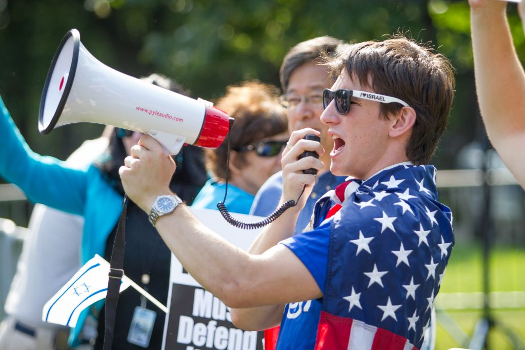 Elliot Hamilton, a pro-Israel student leader at the Claremont Colleges in California, pumps up the crowd during a Boston-held Israel rally during the summer's Operation Protective Edge (photo credit: Elan Kawesch)