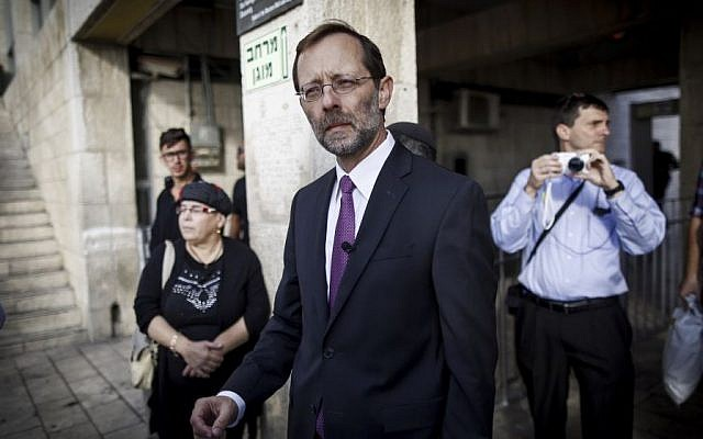 Right-wing parliament member Moshe Feiglin seen outside the closed entrance to the temple Mount in Jerusalem's Old City on October 30, 2014. (photo credit: Yonatan Sindel/Flash90)