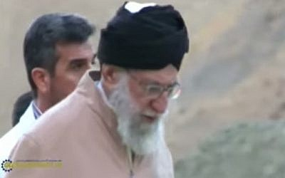 Iran's Supreme Leader Ayatollah Ali Khamenei seen hiking in the mountains near Tehran in a video released October 9 (Photo credit: Youtube screen capture)