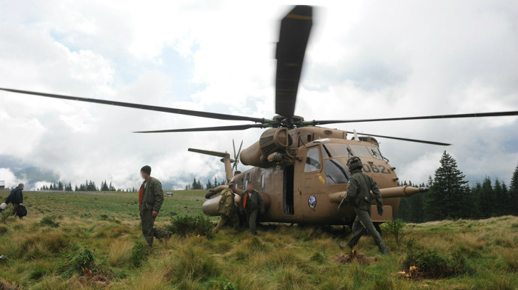 An IDF search and rescue team searching for the bodies of the victims from the helicopter crash in Romania on July 28, 2010. (photo credit: IDF Spokesperson/Flash90)