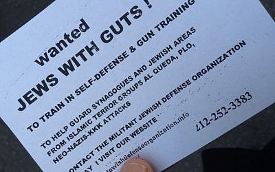 A radical element at the October 20, 2014 pre-production of 'the Death of Klinghoffer' protest distributed flyers calling for 'Jews with guts' to learn shooting with the Jewish Defense League. (Jordan Hoffman/The Times of Israel)
