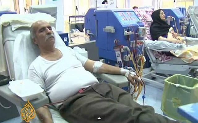 A screen capture of an patients at an Iranian hospital. (YouTube screen capture/Al Jazeera English)