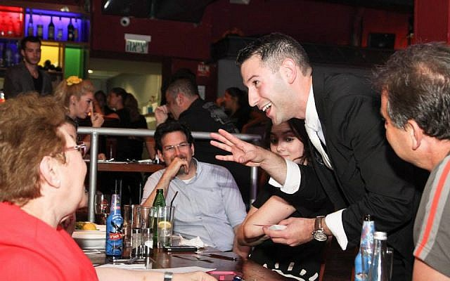 Magician Matan Rosenberg on stage at Sorcerers' Night. (photo credit: courtesy Sorcerers' Night)