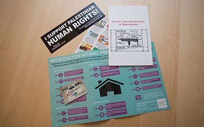 A sampling of anti-Israel materials distributed at the annual Students for Justice in Palestine conference, held Oct. 24-26 at Tufts University in Medford, Massachusetts (photo credit: Elan Kawesch)