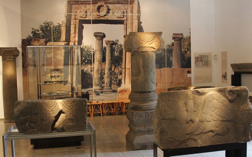 The menora from Ein Mashut and a blow-up of Um el Kanatir at the beginning of restoration, Golan Museum (photo credit: Shmuel Bar-Am)