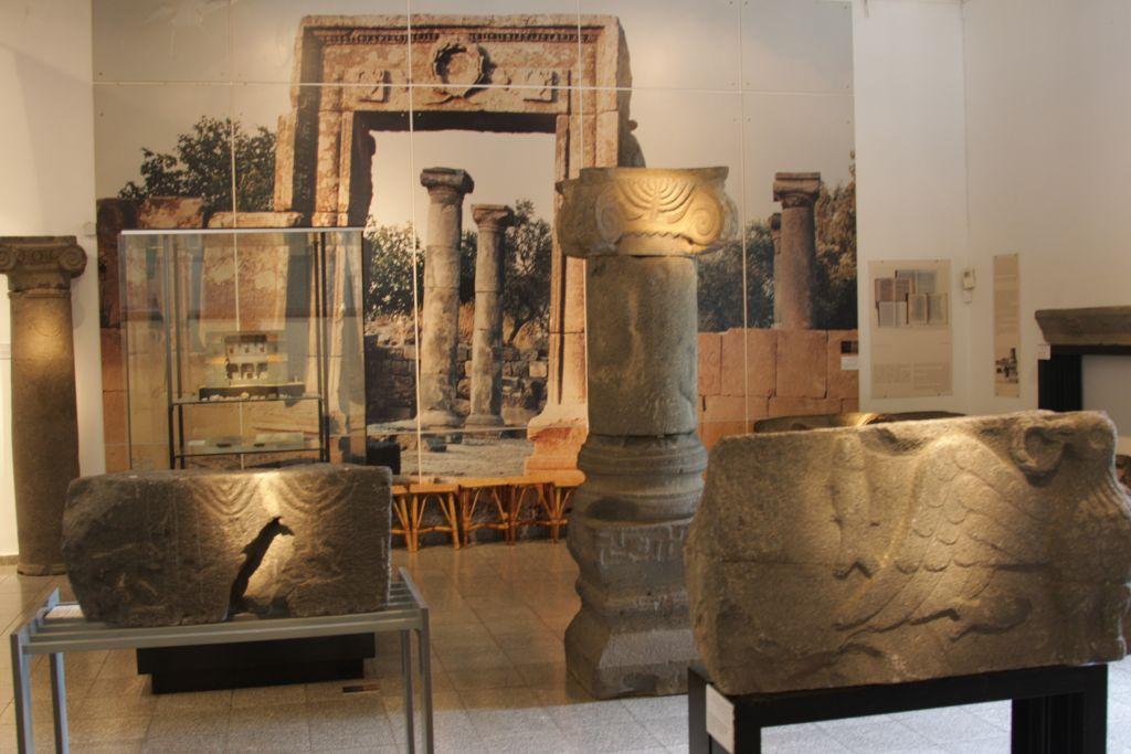 The menora from Ein Mashut and a blow-up of Umm el Kanatir at the beginning of restoration, Golan Archeological Museum (photo credit: Shmuel Bar-Am)