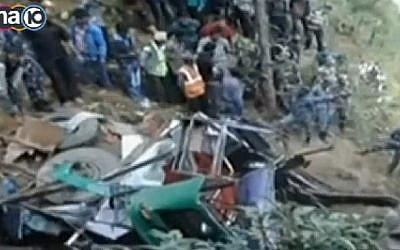 Screenshot from a Channel 10 report on the fatal Nepalese bus accident on October 24, 2014, that claimed the lives of 14 people, including 2 Israeli women.