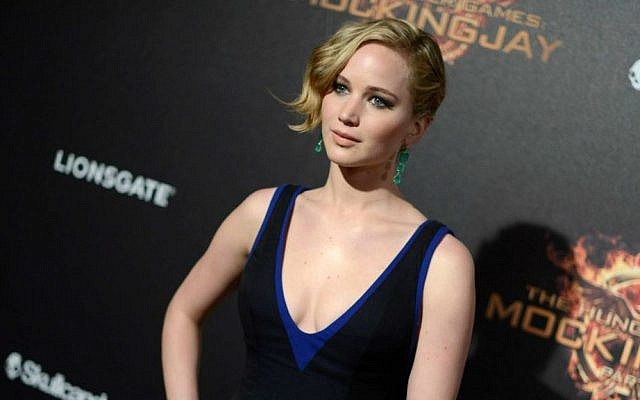 """FILE - In this May 17, 2014 file photo, Jennifer Lawrence appears at the """"Hunger Games: Mockingjay - Part 1"""" party at the 67th international film festival, Cannes, southern France. (Photo by Arthur Mola/Invision/AP, File)"""