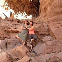 Roni Friedman, an organizer of Yoga Arava with Shanee Habari, one of the yoga instructors, at Solomon's Pillars in Timna Park (photo credit: Jessica Steinberg/Times of Israel)