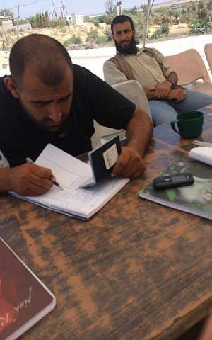 Hamas officials checking passport at Arba-Arba checkpoint at Beit Hanoun as Adam Kawalek entered Gaza. (Courtesy of Adam Kawalek)