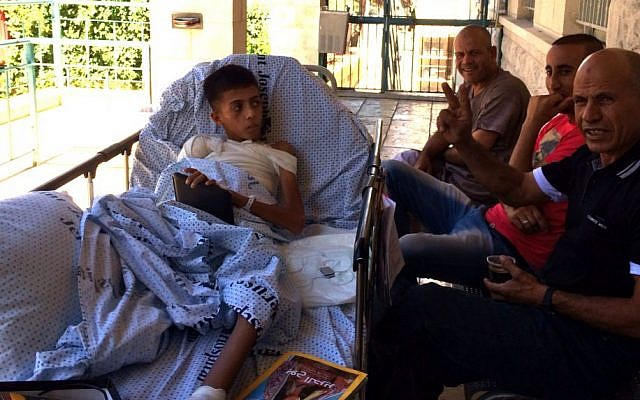 Child amputee from Gaza and family members treated at Augusta Victoria Hospital in East Jerusalem. (Courtesy of Adam Kawalek)