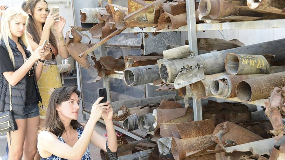 American beauty queens snap photos of a collection of rockets fired into Israel from Gaza. (photo credit: Face of Israel/Facebook)