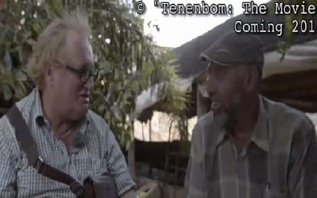 Tuvia Tennenbaum (left) interviews B'Tselem researcher Ataf Abu Rub (R) (Screen capture: Channel 2)
