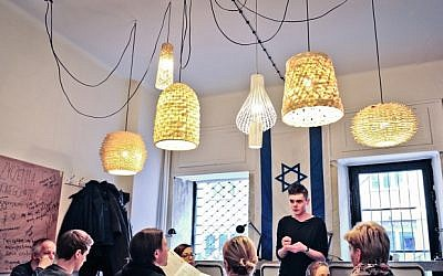 A scene inside the Tel Aviv Cafe in Warsaw, whose menu is full of Tel Aviv favorites like falafel and limonana. (photo credit: courtesy Tel Aviv Cafe)
