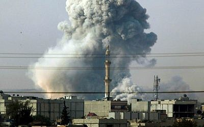Smoke rises following an airstrike by the US-led coalition in Kobani, Syria, October 14, 2014. (AP Photo/Lefteris Pitarakis)