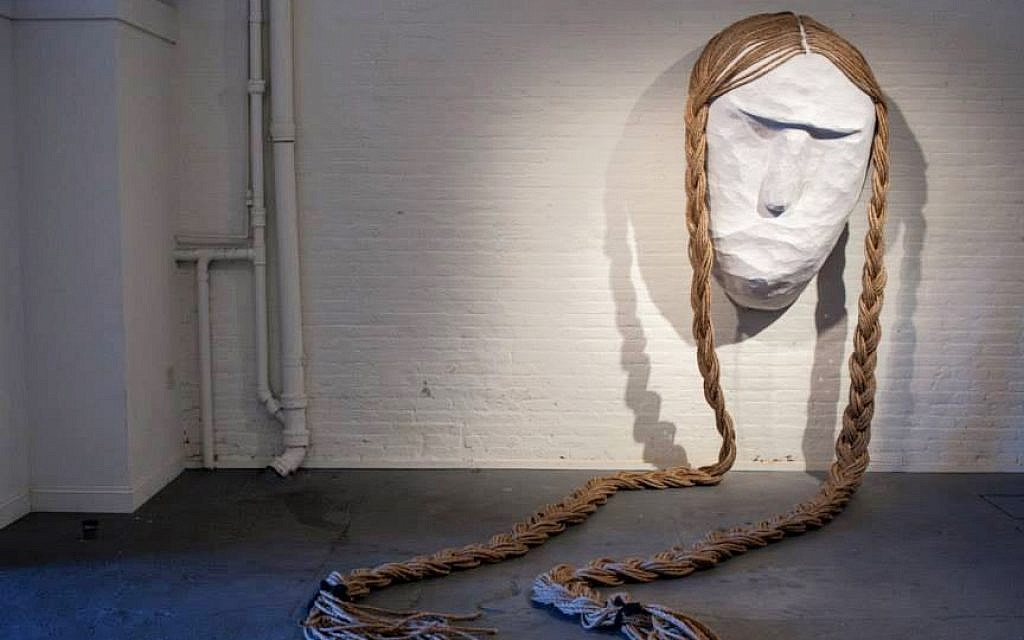 'Eidele Meidele' by Sara Erenthal is made of papier mâché and manilla rope. The head is 5 feet tall and the braids are 25 feet long. Made with a total of 1600 feet of rope. (photo credit: Camilla Cerea)