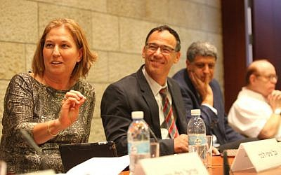 Justice Minister Tzipi Livni (left) makes a point at Israel Academy of Sciences and Humanities conference as State Prosecutor Shai Nitzan, to the immediate right, looks on. October 20, 2014. (photo credit: Michal Fattal)