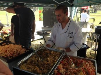 Vendors offering vegan food for sale at a festival in Tel Aviv, Oct. 13, 2014. (photo credit: Ben Sales/JTA)