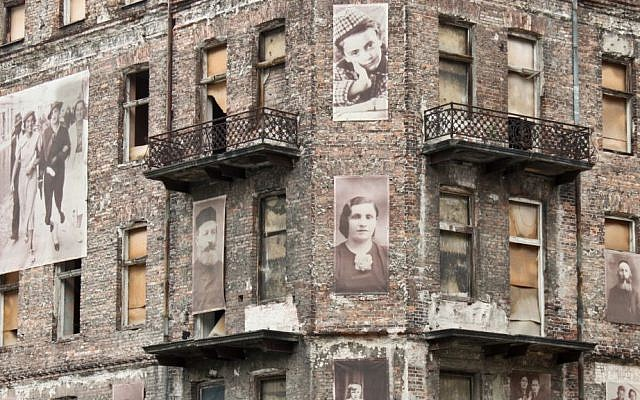 A Holocaust memorial on a building in the Warsaw ghetto via Shutterstock.