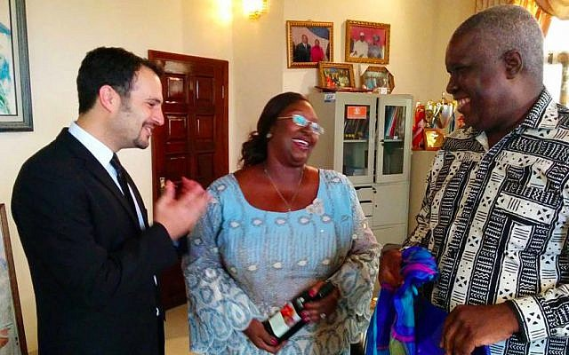 IsraAID's Yotam Polizer, left, meets with the first lady of Sierra Leone Sia Nyama Koroma, center, and Sam Bangura, her policy advisor, and presents them with gifts from Israel. (photo credit: courtesy IsraAID)