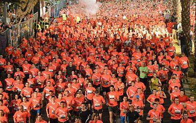 Hundreds of runners at last year's Tel Aviv Night Run; start training for next year's run (Courtesy City of Tel Aviv-Yafo)