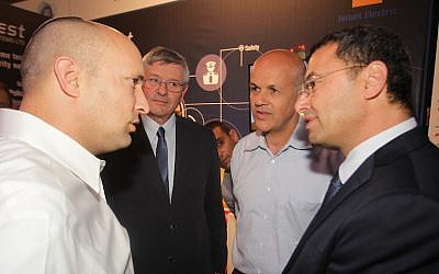 (L to R) Naftali Bennett, Minister of Economy, Yossi Shnek, IEC Chief Information Officer, Eli Glickman, CEO of the IEC, Colonel (Res.) Natan Barak, mPrest CEO, at the Homeland Security Conference in Tel Aviv Tuesday (Photo Credit: Yossi Weiss/IEC)
