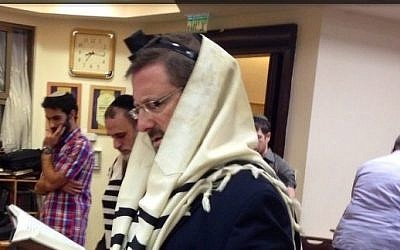Yesh Atid MK Dov Lipman attends morning prayers at the Kehilat Bnei Torah synagogue in Har Nof, Jerusalem, on November 19, 2014. (photo credit: Courtesy)