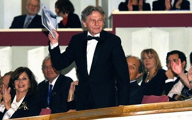 Film director Roman Polanski  waving as he attends a gala concert at the Grand Theatre - National Opera in Warsaw, Poland, on October 27, 2014. (photo credit: AFP PHOTO / PAP/ RADEK PIETRUSZKA)