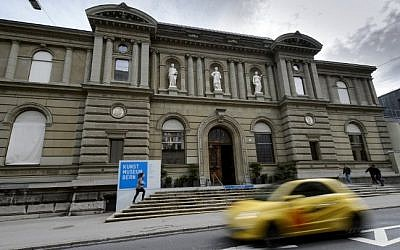 Picture taken on May 8, 2014 shows a car driving past the Museum of Fine Arts (Kunstmuseum) in Bern.(Photo credit: AFP/ FABRICE COFFRINI)