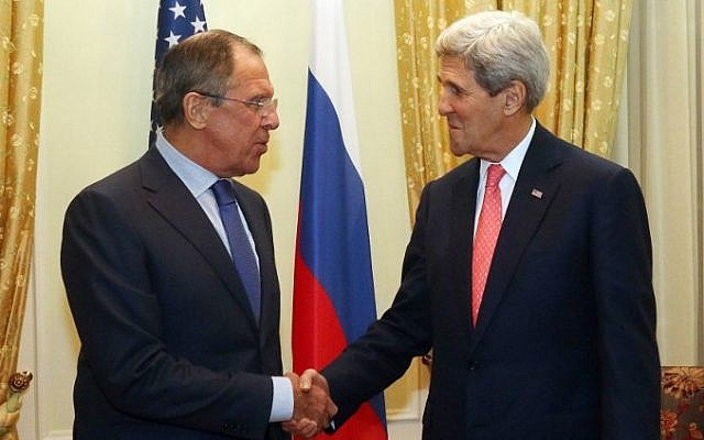 US Secretary of State John Kerry (R) and Russian Foreign Minister Sergei Lavrov shake hands prior to a bilateral meeting on the sidelines of the  nuclear talks with Iran at the Palais Coburg in Vienna on November 23, 2014. (photo credit: AFP/POOL/ RONALD ZAK)