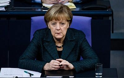 German Chancellor Angela Merkel attends a session of the Bundestag (Lower House of Parliament) in Berlin on November 26, 2014. (photo credit: AFP/CLEMENS BILAN)