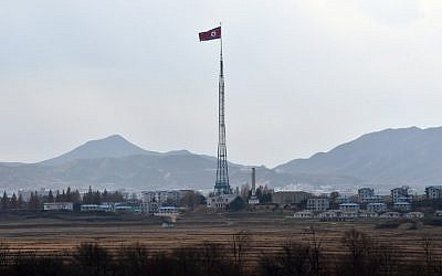 A North Korean flag flutters in the propaganda village of Gijungdong as seen from a South Korean military check point of the truce village of Panmunjom in the Demilitarized Zone dividing the two Koreas on November 12, 2014. (AFP/JUNG YEON-JE)