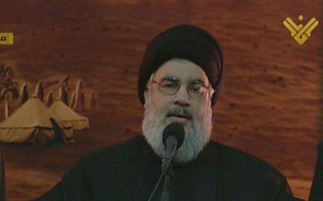An image grab from Hezbollah's al-Manar TV shows Hassan Nasrallah giving a speech in a rare public appearance, Beirut, November 3, 2014. (photo credit: AFP/al-Manar)