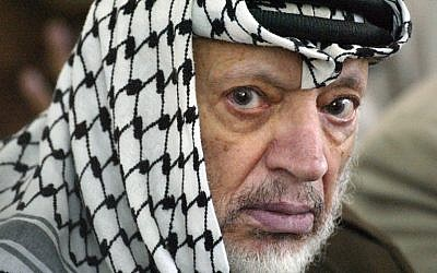 A file picture taken in the West Bank city of Ramallah on June 7, 2002, shows Palestinian leader Yasser Arafat attending Friday Muslim prayers. (photo credit: AFP PHOTO / Thomas COEX)