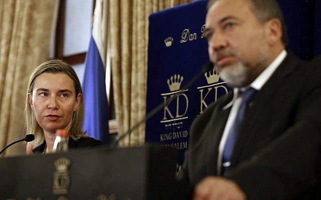The European Union's new foreign affairs chief Federica Mogherini listens to Israeli Foreign Minister Avigdor Liberman during a press conference in Jerusalem, November 7, 2014. (photo credit: AFP/Thomas Coex)
