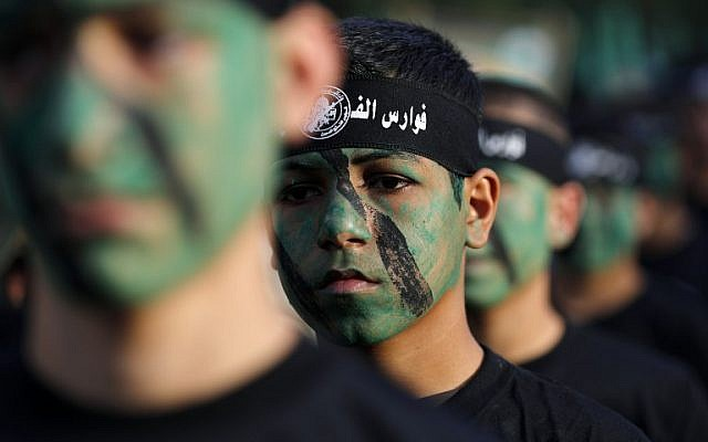 Young members of Hamas' Popular Army in a parade during a graduation ceremony in Jabaliya, in the northern Gaza Strip on November 7, 2014.  (Photo credit: AFP/Mohammed Abed)